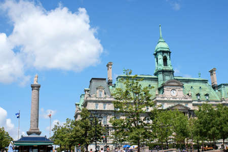 Montreal, Canada - July 26, 2008: Place Jacques Cartier (Jacques Cartier Square), Nelson Column and Montreal City Hall (Hôtel de Ville de Montréal) with its copper roof. the City Hall was built in Second Empire Style between 1872 and 1878 in Old Montrea Stock Photo - 16425472