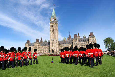 Ottawa, Canada - August 08, 2008: changing of the guard in front of the Parliament of Canada on Parliament Hill in Ottawa, Canada. A lot of tourist attending the show.