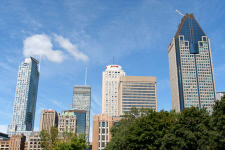 Montreal, Canada - August 19, 2008: skyscrapers and old Winsor Station in Montreal. Windsor Station was built in Montreal between 1887 and 1889 by New York architect Bruce Price. It's no longer used as a railway station since 1981 and in 1990 it was desig Stock Photo - 16425482