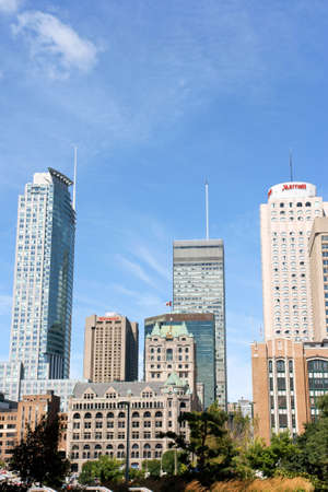 Montreal, Canada - August 19, 2008: skyscrapers and old Windsor Station in downtown Montreal. Windsor Station was built in Montreal between 1887 and 1889 by New York architect Bruce Price. It's no longer used as a railway station since 1981 and in 1990 it Stock Photo - 16425477