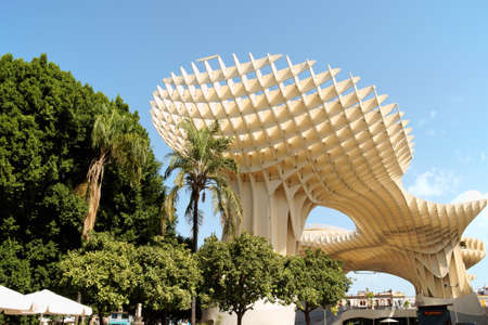 Seville, Spain - August 12, 2011: Metropol Parasol, by Juergen Mayer-Hermann, in Plaza de la Encarnacion in old Seville. This wooden structure was inspired by Seville Cathedral and ficus plants. It was built between 2005 and 2011 and hosts a market and a