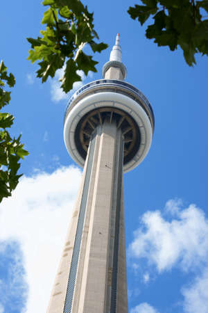 Toronto, Canada - August 1, 2008: CN Tower against a cloudy sky, Toronto, Ontario. It is one of the symbols of Canada with its 553.33 metres (1,815.4 ft) height.  Stock Photo - 18017514