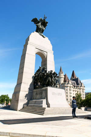 Ottawa, Canada - August 8, 2008: National War Memorial designed by Vernon March and unveiled by King George VI in 1939. The monument is composed of 23 bronze figures and a stone arch.