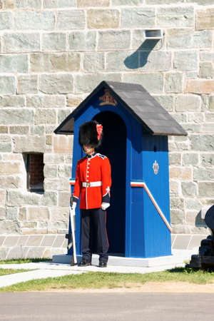 17th: Quebec City, Canada - August 15, 2008  A soldier from Royal 22nd Regiment with gun stands in front of a sentry box near the entrance of the Citadelle  The Citadelle of Quebec City was a military installation and residence  The construction started in 17th