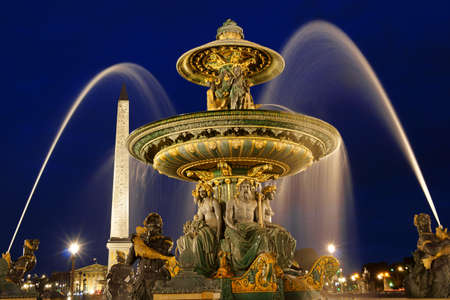 concorde: The rivers fountain  Fontaine des Fleuves  in Place de la Concorde by night in Paris, France  Selective focus  Stock Photo