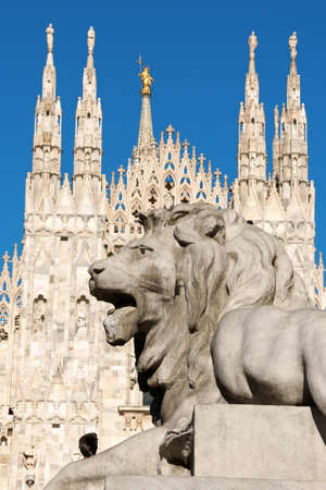 Piazza del Duomo in Milan, Italy  Detail of lion statue and Duomo di Milano  Milan Cathedral  in the background