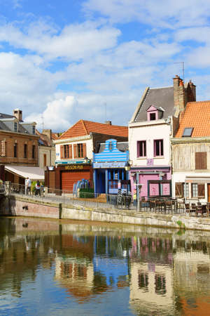 Amiens, France - August 11, 2013  Quai Belu at Saint Leu Quarter and Somme river on a summer cloudy day in Amiens, France  This old quarter made of small, colorful houses, shops and restaurants is the most historic and picturesque part of the town   Some  Editorial