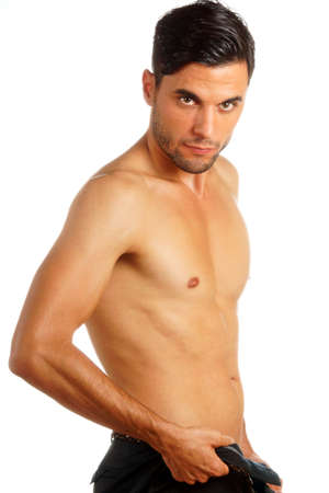 30 year old: Shirtless 30 year old caucasian man undressing over white background Stock Photo