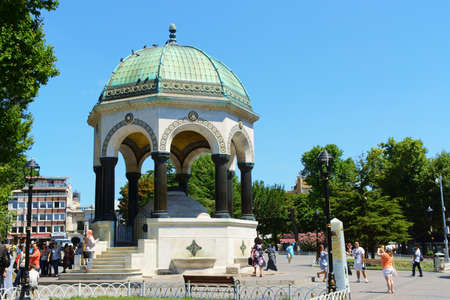 hippodrome: Istanbul, Turkey - July 20, 2015: the German Fountain rises on the north side of Sultan Ahmet Square, the ancient Hippodrome of Constantinople. This marble, copper and mosaic fountain was a present of German Emperor Wilhelm II to commemorate the anniversa