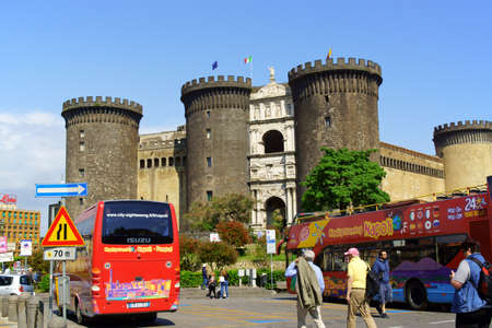 Naples, Italy - May 12, 2018: Castel Nuovo (New Castle) better known as Maschio Angioino (Angevin Keep) is one of the most visited monuments in Naples. This medieval castle was built when the capital of the Kingdom of Naples was moved from Palermo to Napl