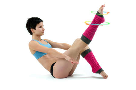 legwarmers: Woman doing aerobic exercises with colorful cirles around one leg