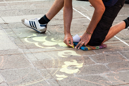 busker: FERRARA, Italy - August 22, 2015: Buskers Festival 2015 in Ferrara, Emilia Romagna, Italy. Busker Festival is a popular event with street artists which is held annually in the historic center of Ferrara Editorial