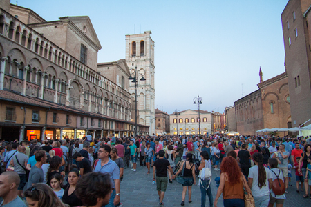 busker: FERRARA, Italy - August 22, 2015: Visitors to Buskers Festival 2015 in Ferrara, Emilia Romagna, Italy. Busker Festival is a popular event with street artists which is held annually in the historic center of Ferrara Editorial