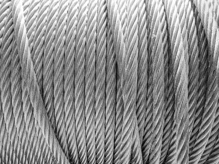 steel cable: resistant steel cable rolled up in black and white Stock Photo