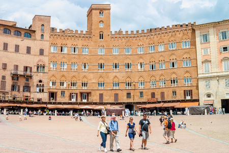 palio: Siena, Italy - June 17, 2010:Tourists visit the famous Piazza del Campo in Siena, Italy. In the medieval square it takes place the famous Palio di Siena