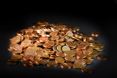 hoard: Pile of copper European currencies on a black background Stock Photo