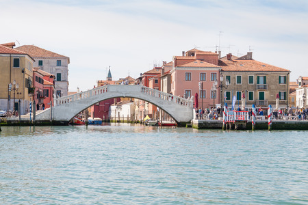 Chioggia, Italy - April 30, 2016: The Vicos bridge in Chioggia, Italy, seen from the Venetian lagoon. The famous bridge, the destination of many tourists, was built in 1685.