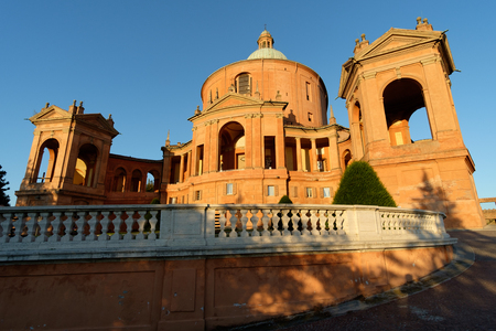 Facade of the Catholic Cathedral of St. Luke on a hillside of Bologna, Italy, at sunset