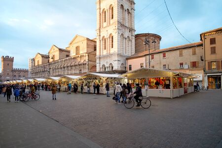 wares: Ferrara, Italy - December 29 2016: Piazza Trento Trieste in Ferrara, Italy. Christmas markets that takes place in the square in the historic center of Ferrara, with many artisans displaying their wares.