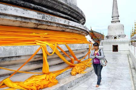 goodluck: A modern woman pray for goodluck at Wat Pramahatad,Nakhonsrithammarat,Thailand