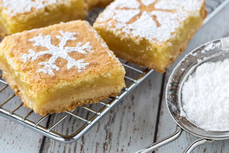 Close up macro view of lemon squares with snowflake designs ready for eating.