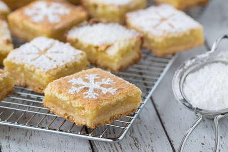 Lemon squares with powdered sugar.