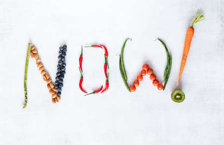 Healthy foods arranged to spell the word now. Banco de Imagens
