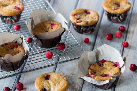 Top down view of several cranberry fruit explosion muffins fresh out of the oven ready for eating. Archivio Fotografico - 137215292