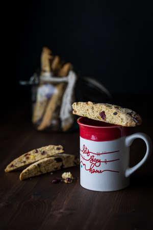 Close up of a mug of coffee with biscotti. Coffee break concept.