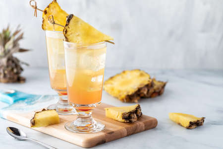 Pineapple Sunrise Mimosas ready for drinking with copy space to the right. Archivio Fotografico