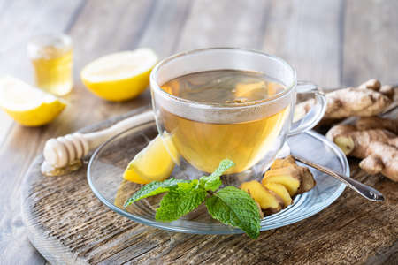 Hot steamy green tea with ginger, lemon and honey.