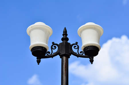 White Street Lamp On Blue Sky with White Cloud photo