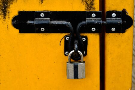 guard house: Black Bolt Lock On An Old Yellow Door