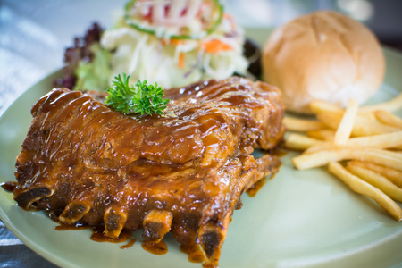 rib steak grilled with potato french fries and bread photo