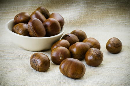 Dried Chestnuts on brown fabric  photo