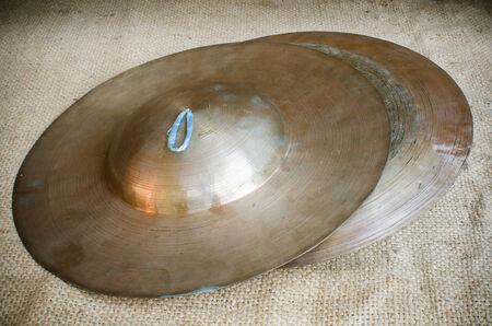 cymbals: Thai Tradition medium size cymbal on brownish sack