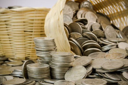 Stack of Thai baht coins stock photo in bamboo bucket photo