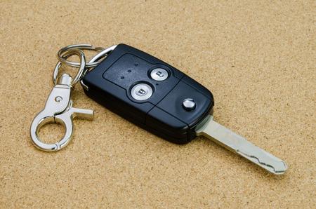 Car key isolate on cork background photo