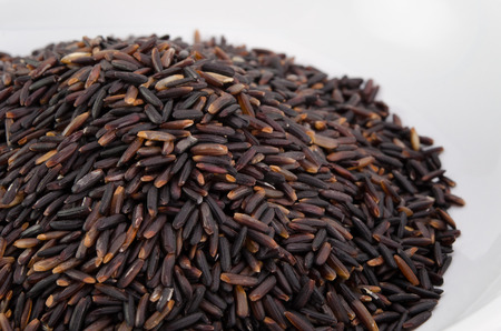 black rice: Organic black rice on white background Stock Photo
