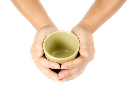 Image of tea cup with hand on white background photo