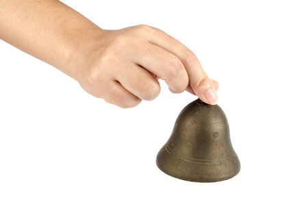 liberty bell: Image of brass bell in hand on white background