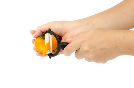 persimmons: Yellow persimmons in womans hand on white background