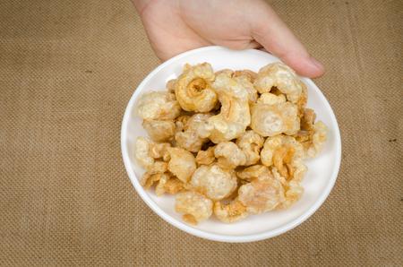 chicharon: Image of fried pork skin in white dish Stock Photo