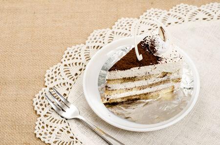 cake in white dish on brown sack photo