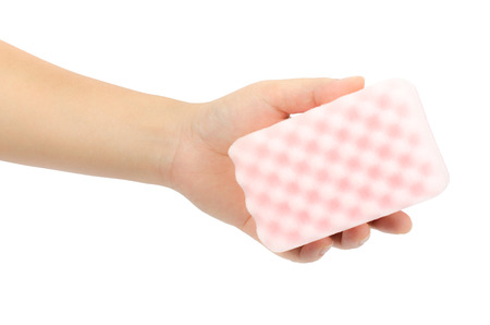 Triple layer sponge in hand isolate on white background photo