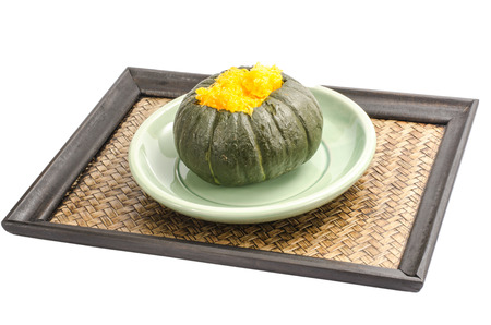 Thais food, Egg custard in pumpkin in green ceramic dish photo