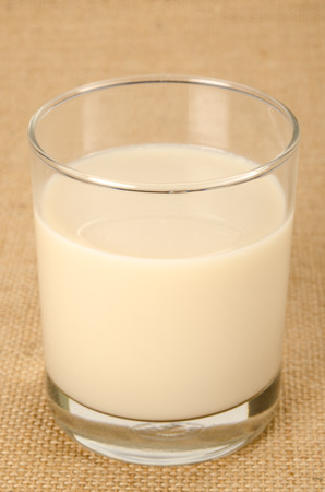 soymilk: Image of glass of soy bean milk on brown sack background