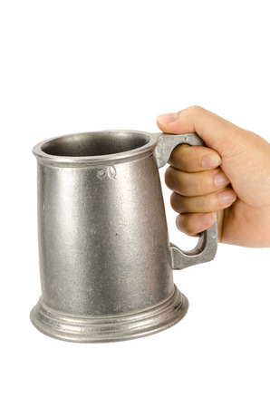 pewter mug: Image of old aluminum beer mug hold by hand on white background