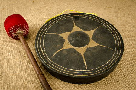 Image of ancient Thais gong on brown sack background photo