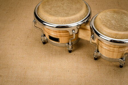 bongo drum: Latin Wooden Bongo on brown sack background